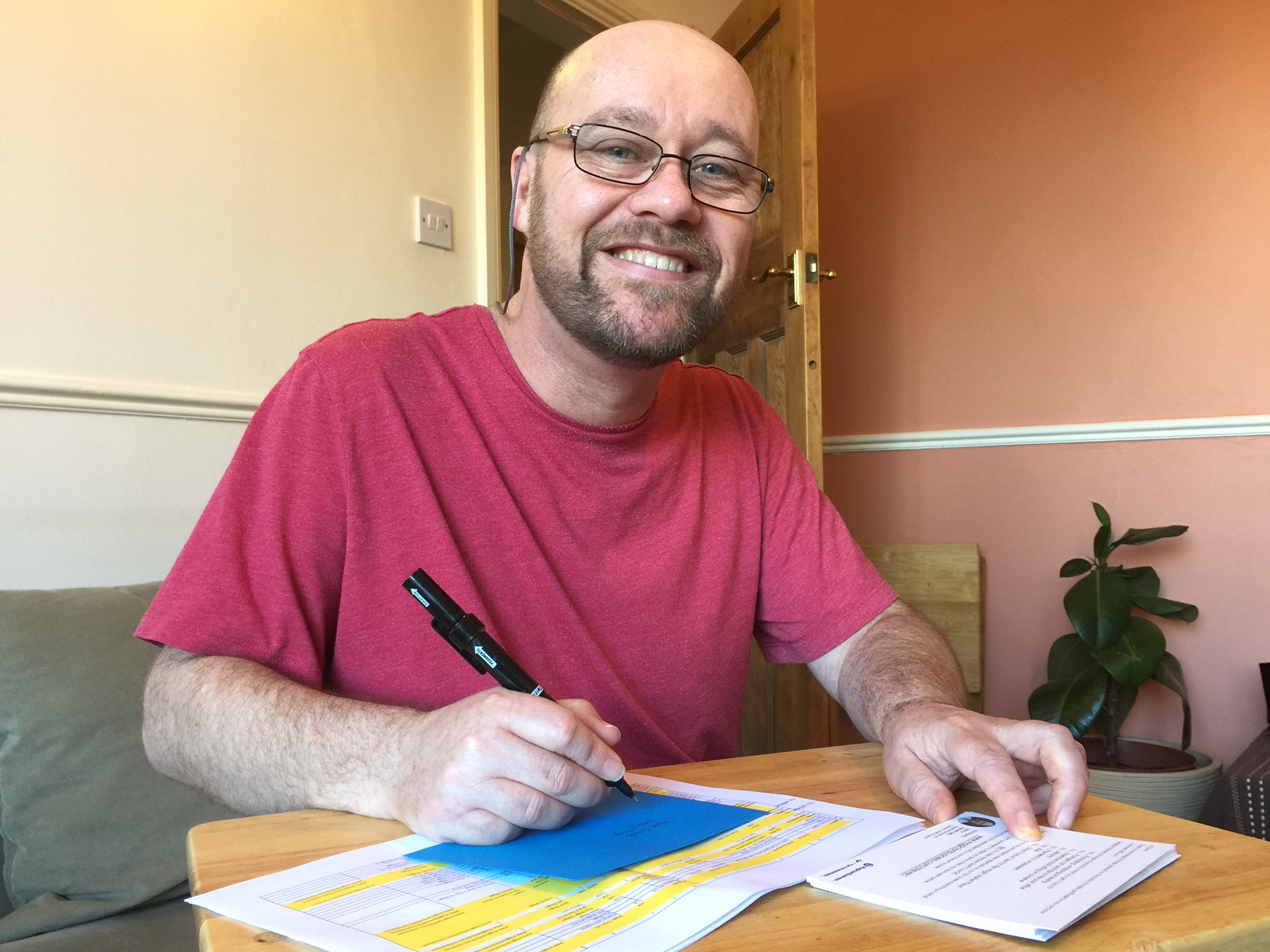 Ken Kelly hand-writing letter envelopes for prospective affiliates